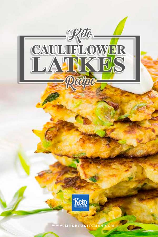 Low Carb Cauliflower Latkes stacked on a plate and topped with sour cream