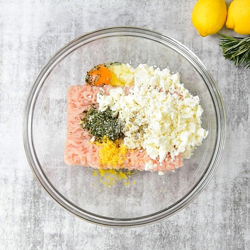 Keto Chicken Feta Meatballs Ingredients in a glass mixing bowl