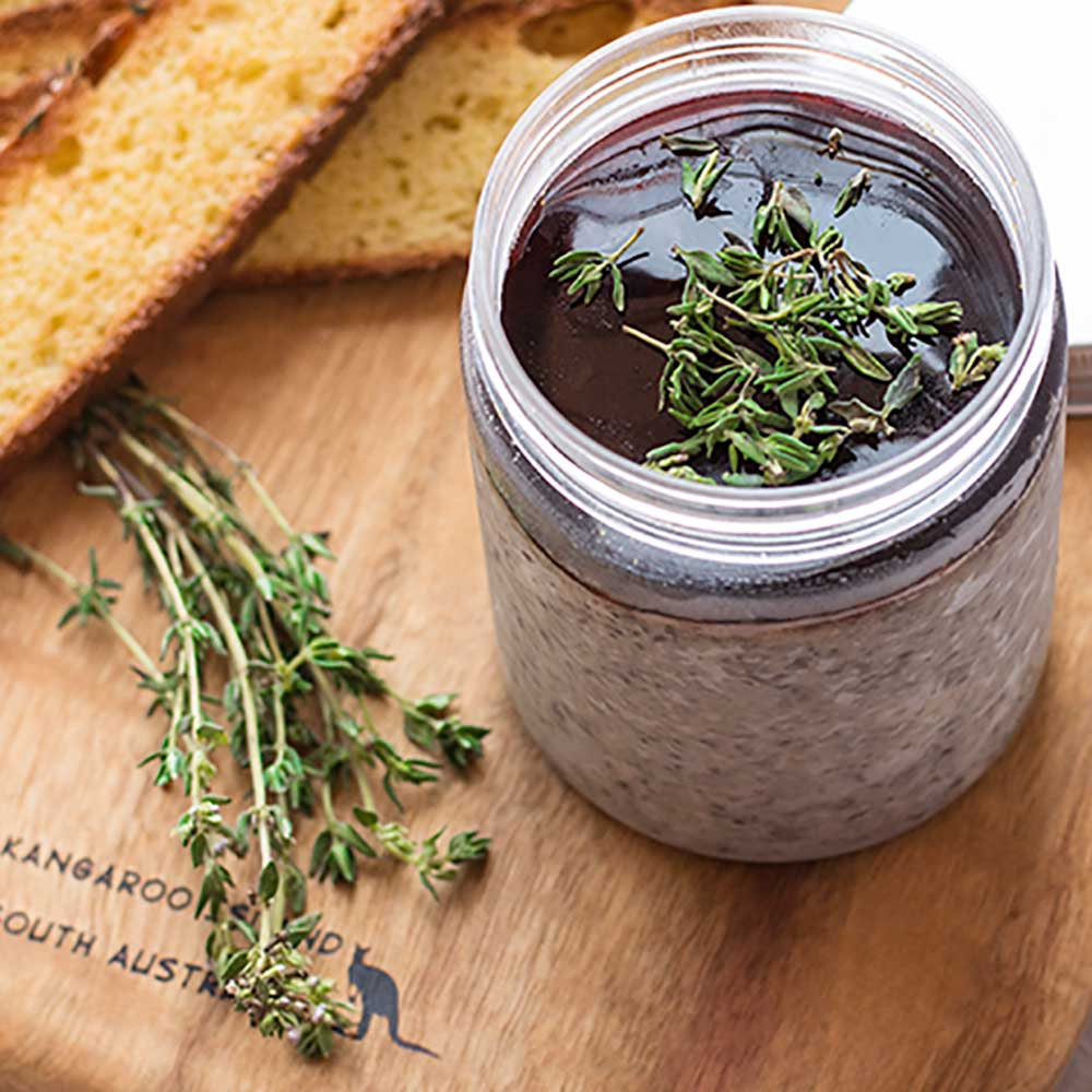 Keto Mushroom Pate on a wooden board with crispy low carb bread