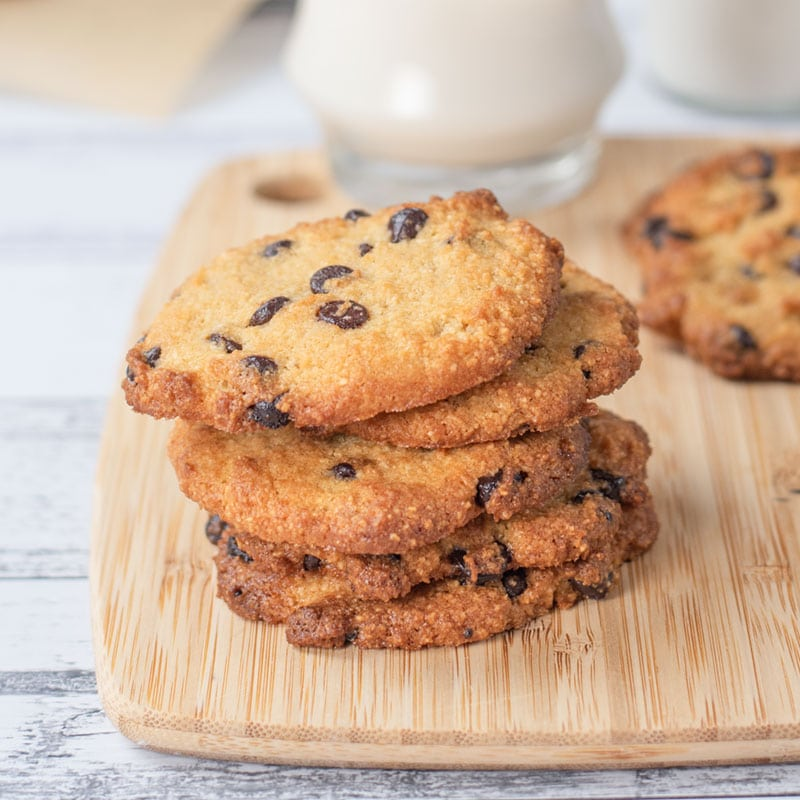 Keto Chocolate Chip Cookies stacked in a pile