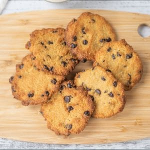 Keto Chocolate Chip Cookies place in a circle on a wooden platter