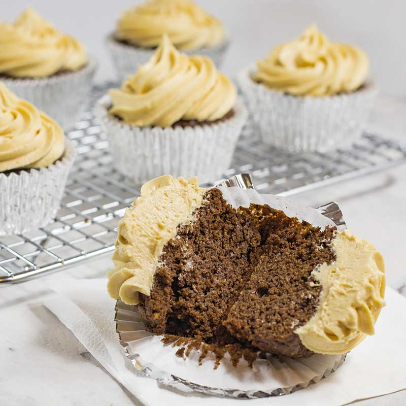 Keto Chocolate Peanut Butter Cupcake cut in half showing the soft, fluffy cake center