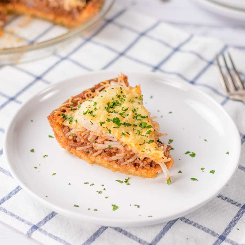 A slice of Keto Spaghetti Bolognese Pie on a plate