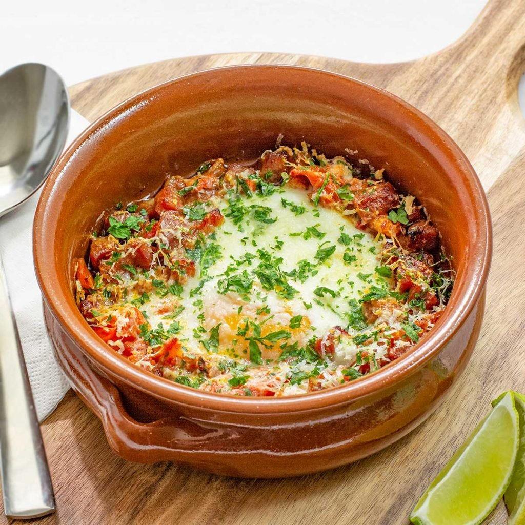 This keto breakfast recipe combines spicy chorizo and eggs to make a delicious gluten free dish we call Keto Spanish Baked Eggs. It's a healthy dish for breakfast, lunch or dinner.