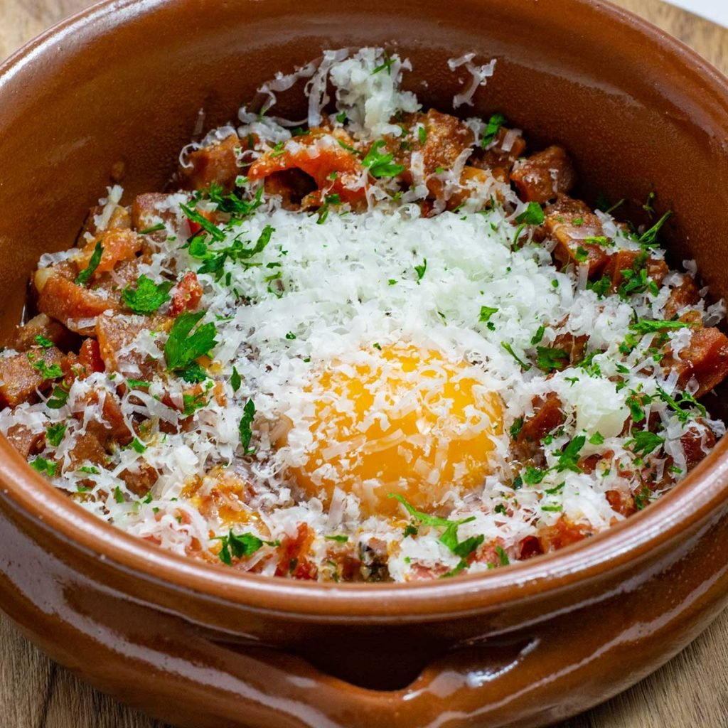 Keto Spanish Baked Eggs ingredients in a tapas dish