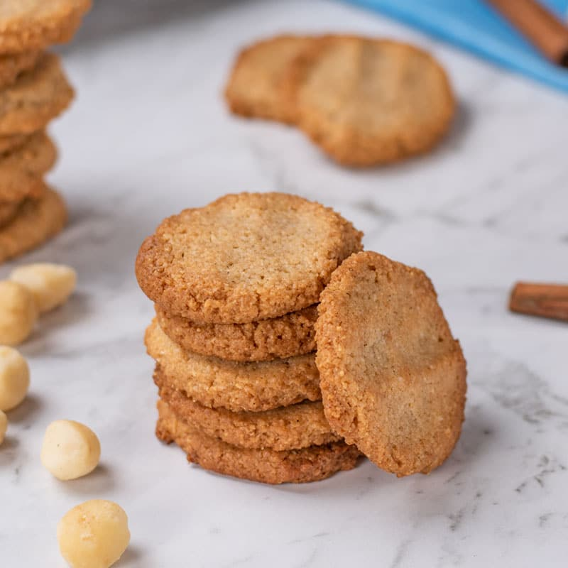 Keto Macadamia Cookies stacked in a pile