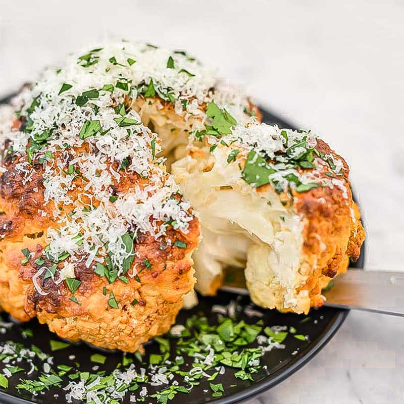 Whole roasted cauliflower with garlic and cheese.