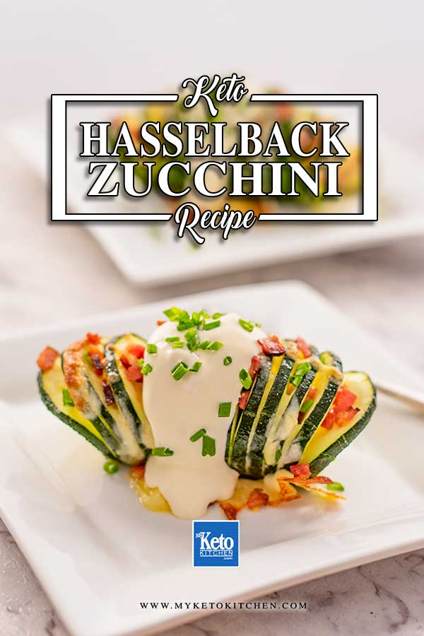 Image shows a keto hasselback zucchini stuffed with cheese and bacon and topped with sour cream and chives sitting on a white plate, there is a second plate in the background.