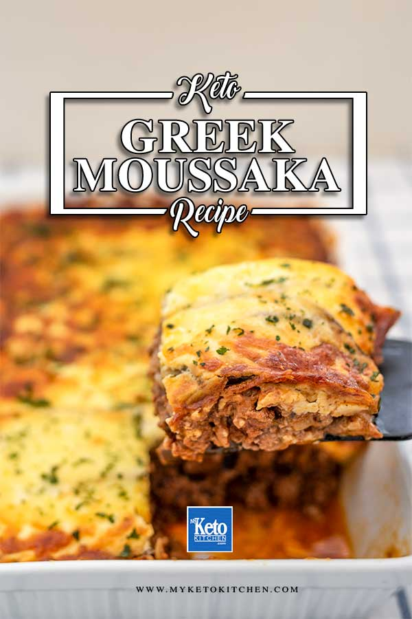 "Image of a slice of Keto Moussaka being lifted out of the cooked casserole dish with a black spatula. The words ""keto recipe"", ""greek moussaka"" and ""www.myketokitchen.com"" are written over the image"