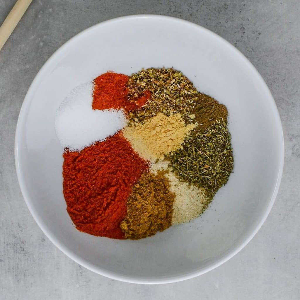 Cajun spice mix ingredients in a white bowl