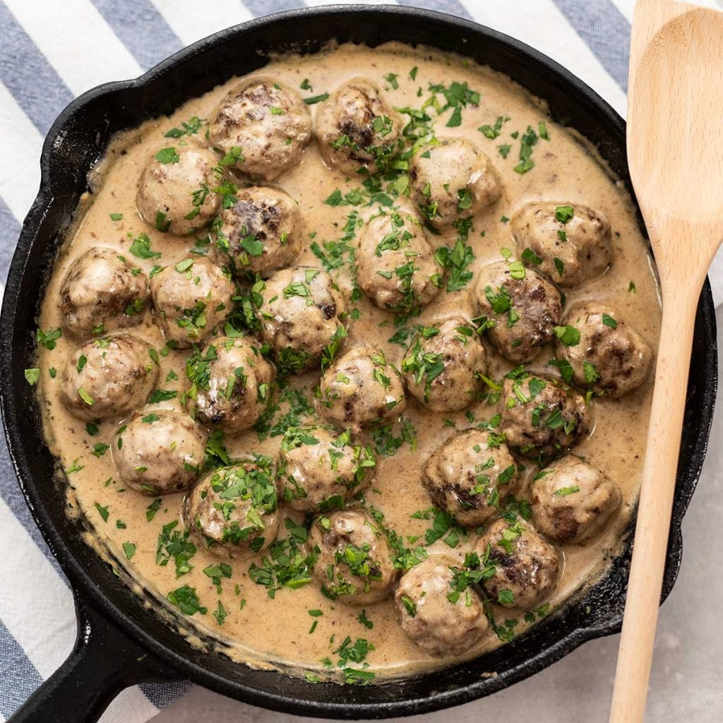 Keto Swedish Meatballs in a cast iron skillet