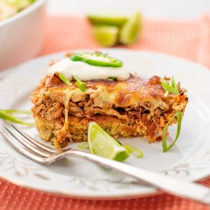 A slice of Keto Chicken Tamale Pie on a white plate