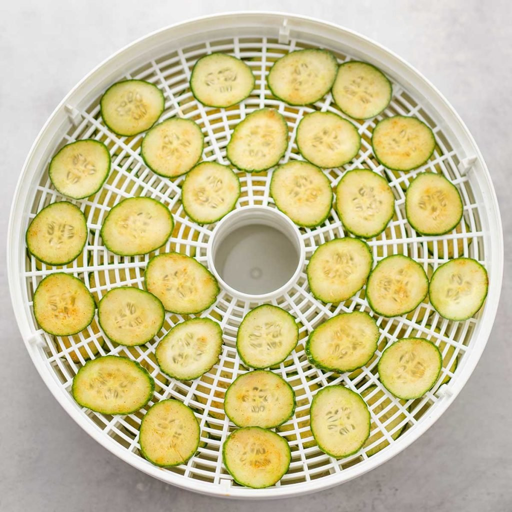 Raw Keto cucumber chips on a dehydrator tray