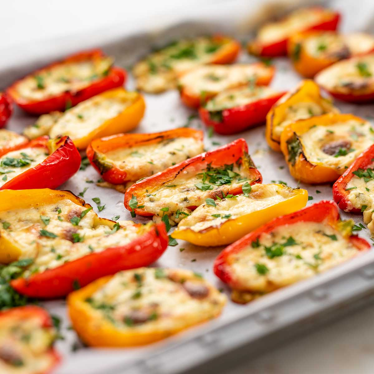 Keto Quest Stuffed Mini Peppers on a lined cookie sheet