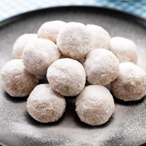 keto snowball cookies on a plate