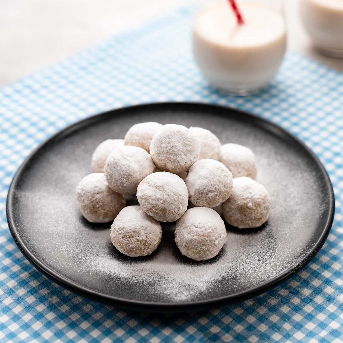 Keto Snowball Cookies on a black plate