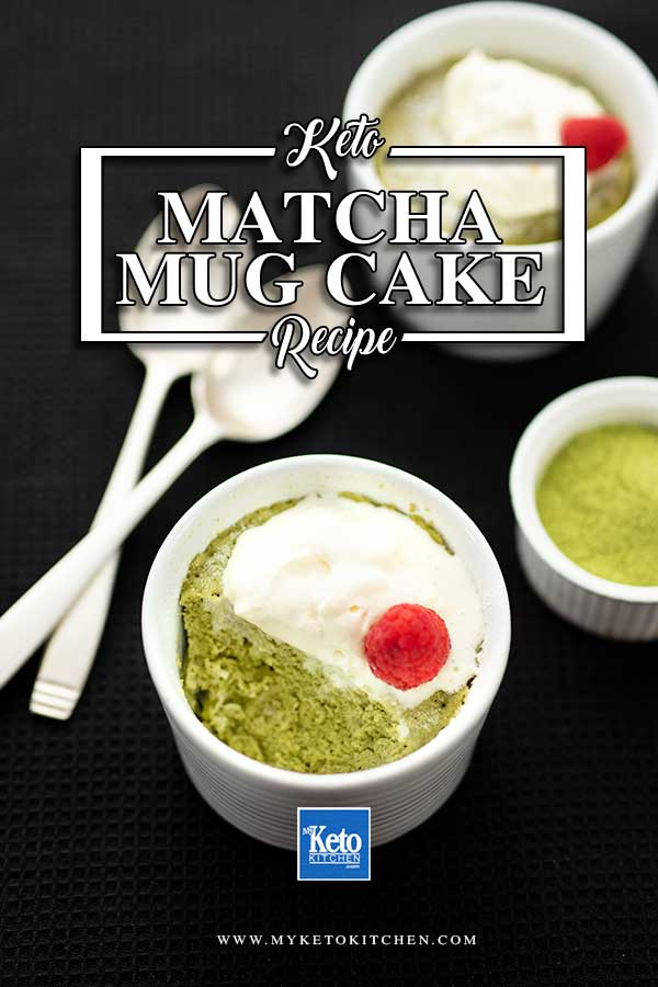 Keto Matcha Mug Cake topped with cream and a raspberry with a spoonful removed in a white ramekin on a black background
