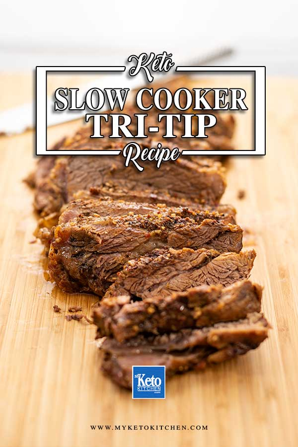 Slow Cooker Keto Tri Tip slices on a wooden board