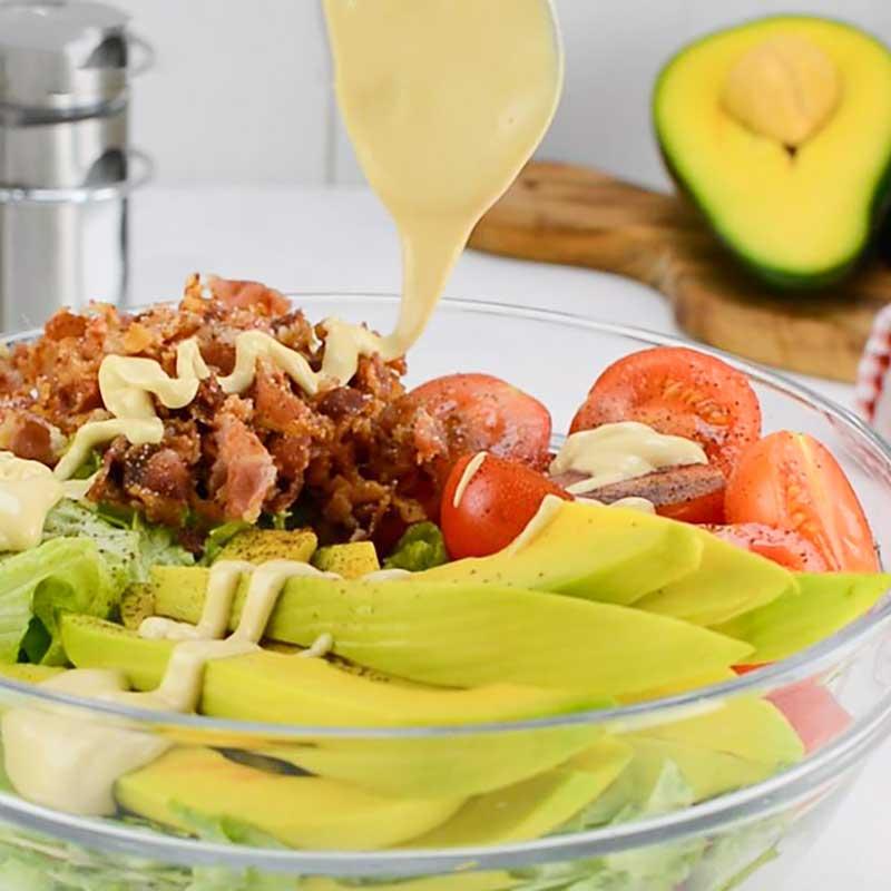 Keto BLT Salad in a bowl drizzled with Garlic Aioli