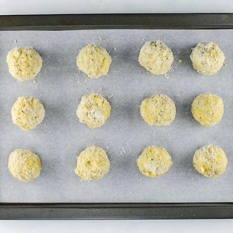 Keto Arancini Balls on a cookie sheet, ready to bake