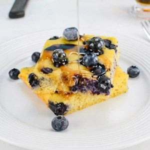 Keto Sheet Pan Pancakes with blueberries on a white plate