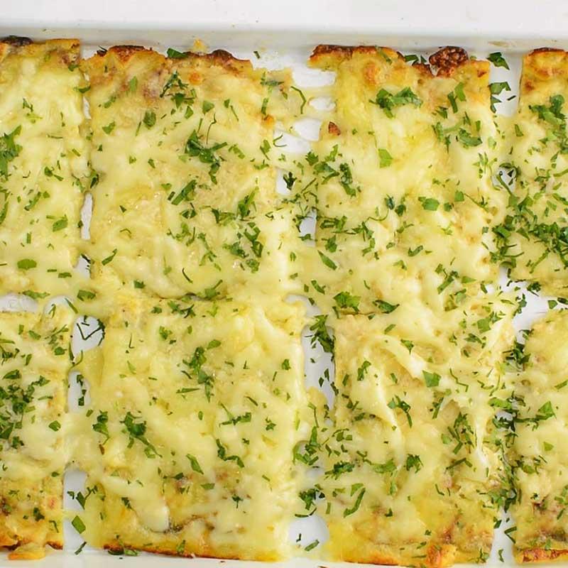 Keto Zucchini Breadsticks on a baking pan