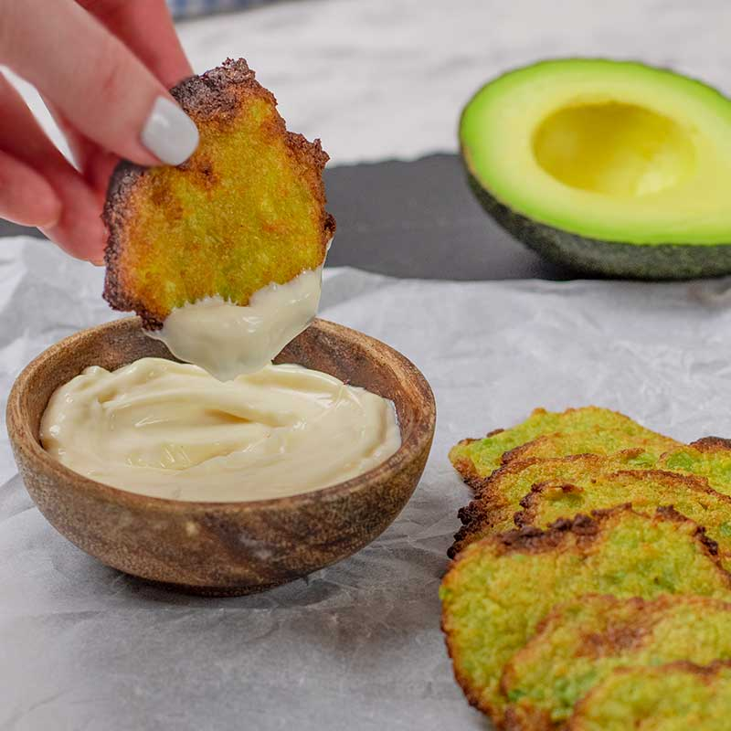 Keto Avocado Chips dipped into garlic aioli