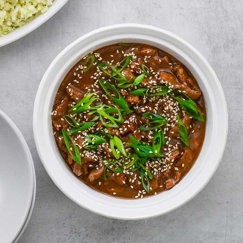 Keto Mongolian Beef in a white serving dish