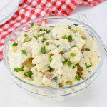 "Keto Cauliflower ""Potato"" Salad in a glass bowl"