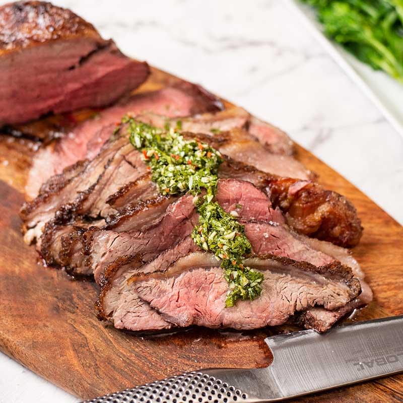 Keto Steak Picanha on a board with chimichurri sauce