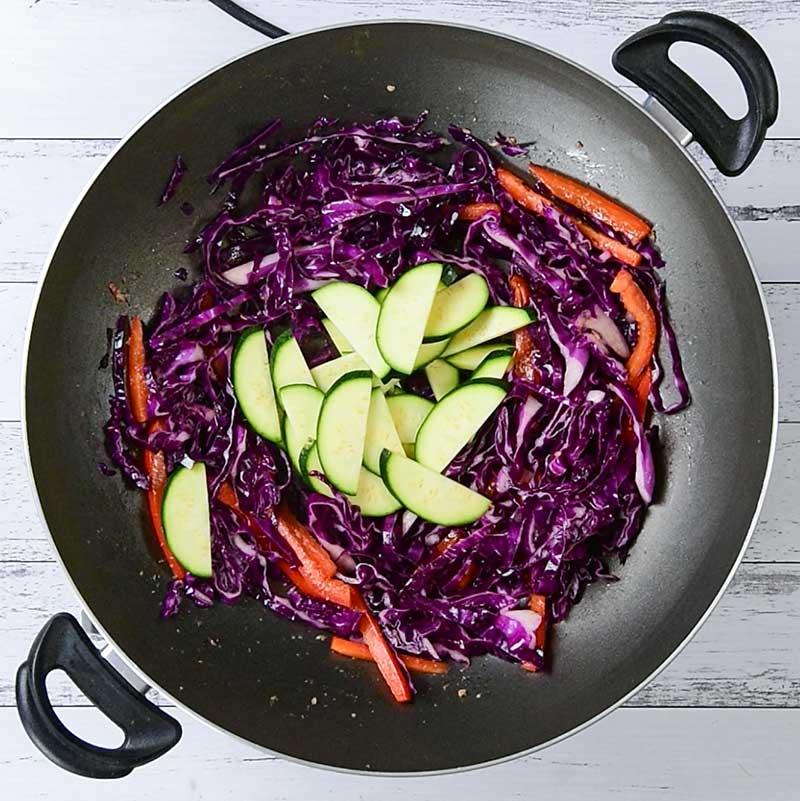 Keto Beef and Vegetable Stir Fry Ingredients cooking in a wok
