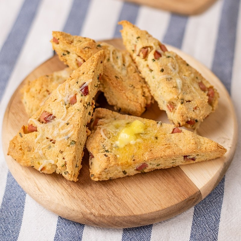 Keto Ham and Cheddar Scones on a wood platter