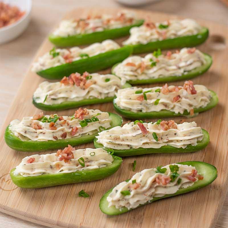 Keto Bacon Ranch Stuffed Cucumbers on a wooden board