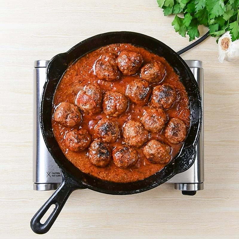Keto Meatball Subs Ingredients - meatballs simmering in keto marinara sauce