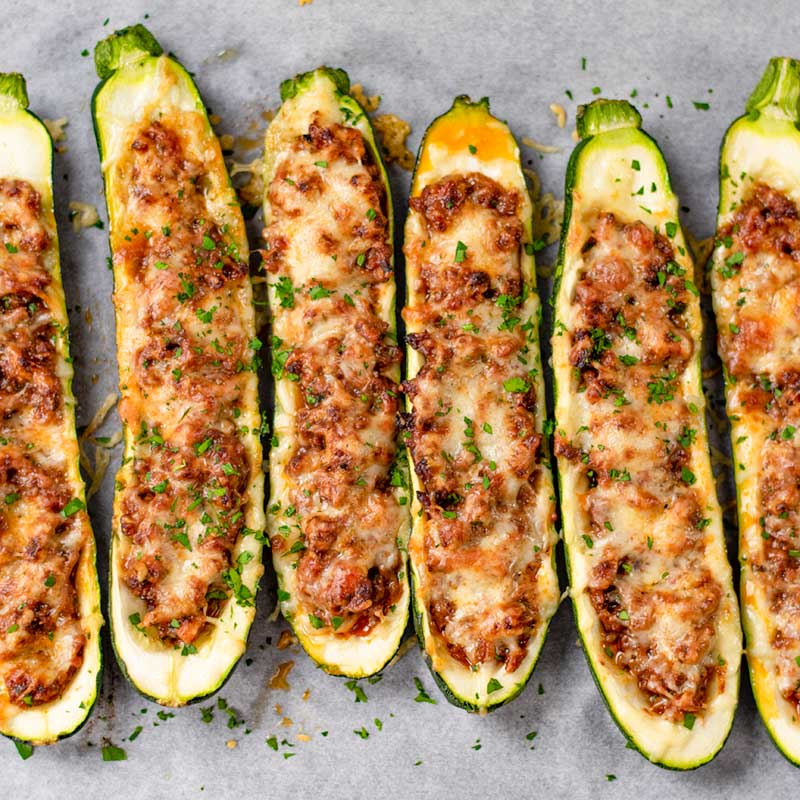 Cooked Keto Zucchini Boats on a cookie sheet
