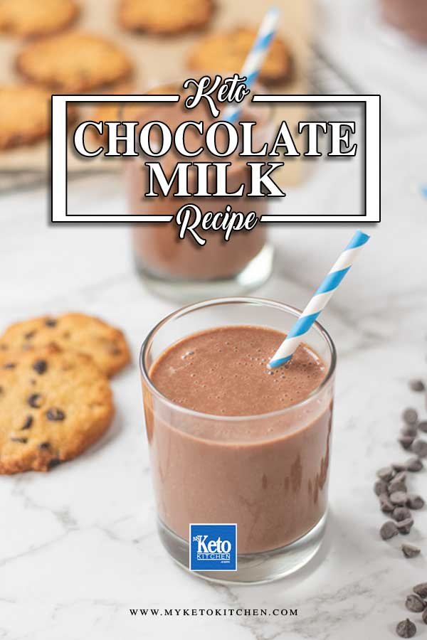 Keto Chocolate Milk in a glass with a blue and white striped straw
