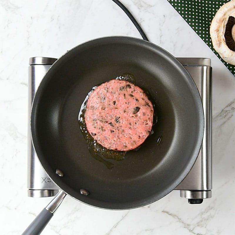 Keto Turkey Burger cooking in a frying pan