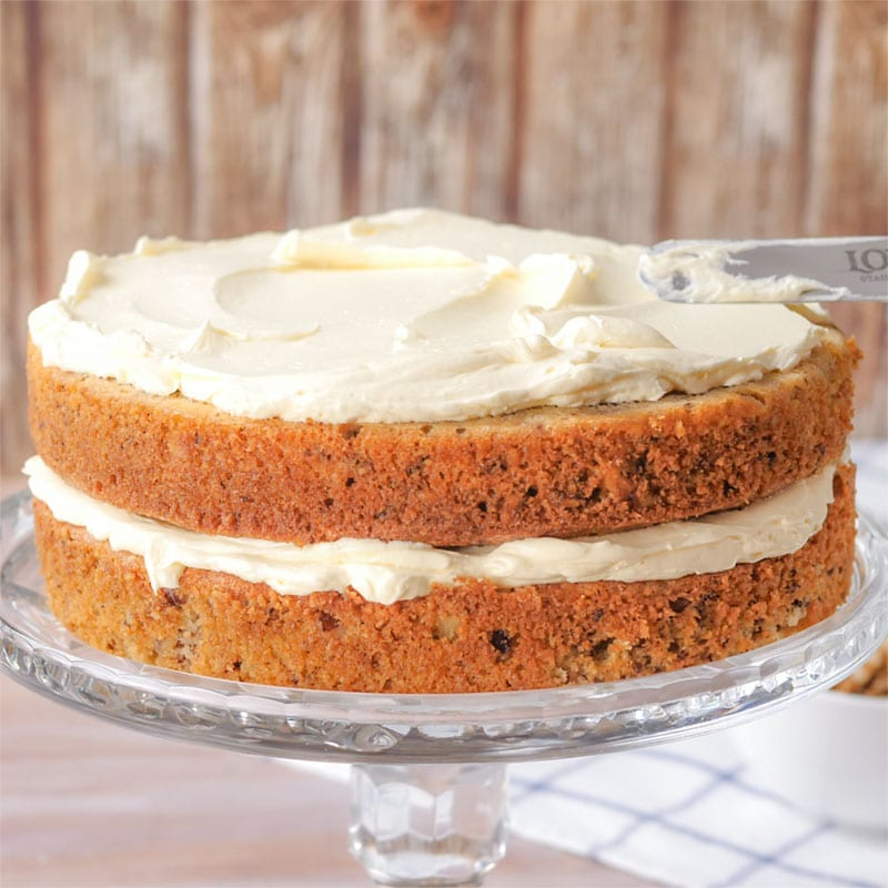 Keto Buttercream Icing being spread onto a Keto Walnut Cake