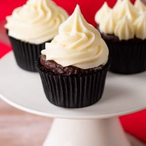 Keto Buttercream piped onto a chocolate cupcake