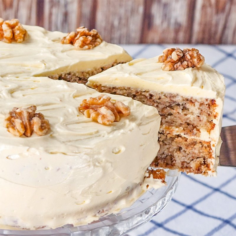 Keto Walnut Cake with a slice being removed from the side.