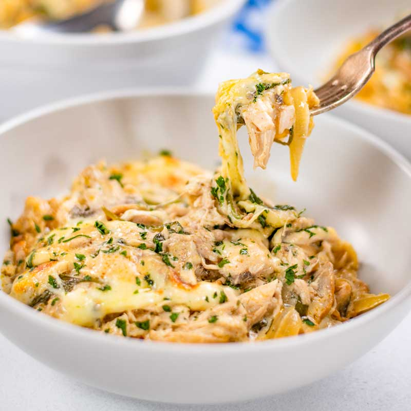 Easy Keto Chicken Bake in a bowl with a forkful being removed.
