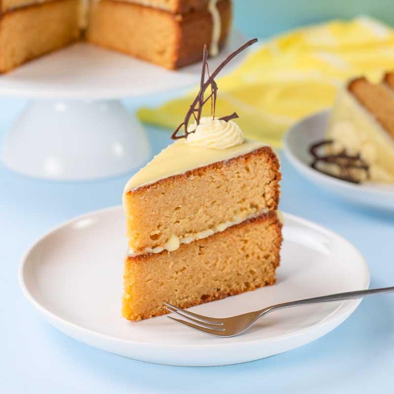 A slice of Keto Caramel Mud Cake on a white plate.