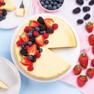 Keto Vanilla Cheesecake topped with berries.