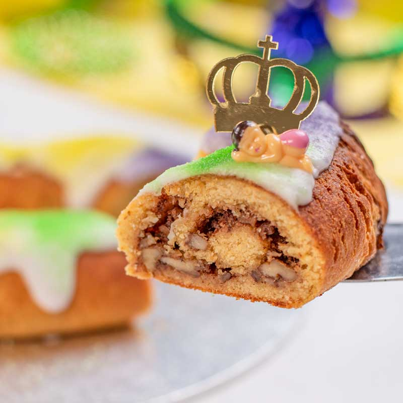 A slice of Keto King Cake showing the center cinnamon pecan swirl.