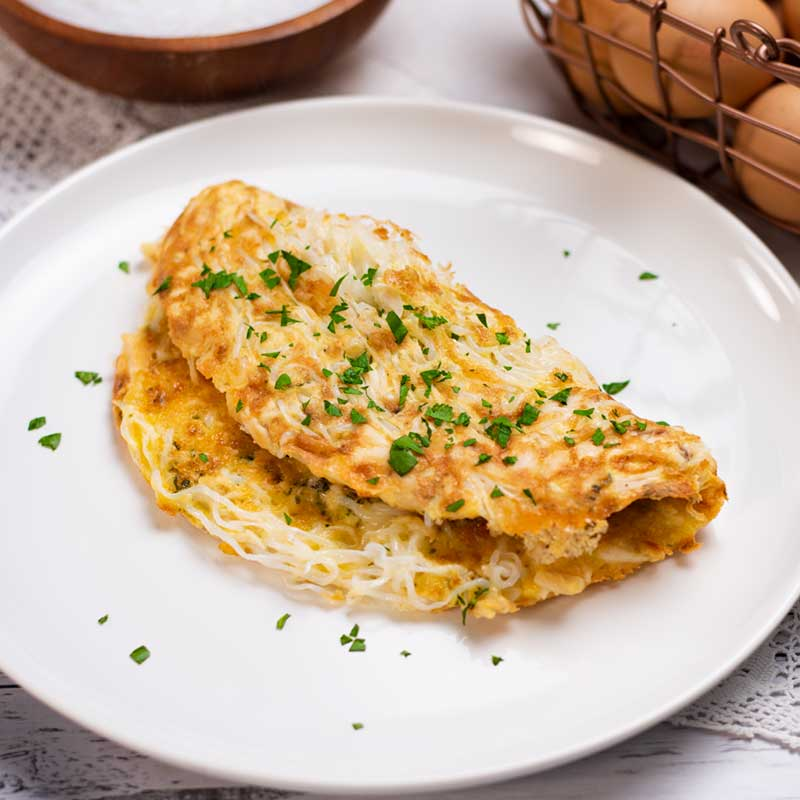 Keto Chicken Noodle Omelette on a white plate.