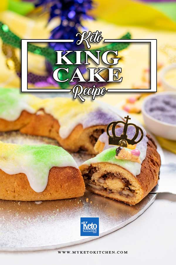 Keto King Cake with a slice cut out to show the center cinnamon pecan swirl.