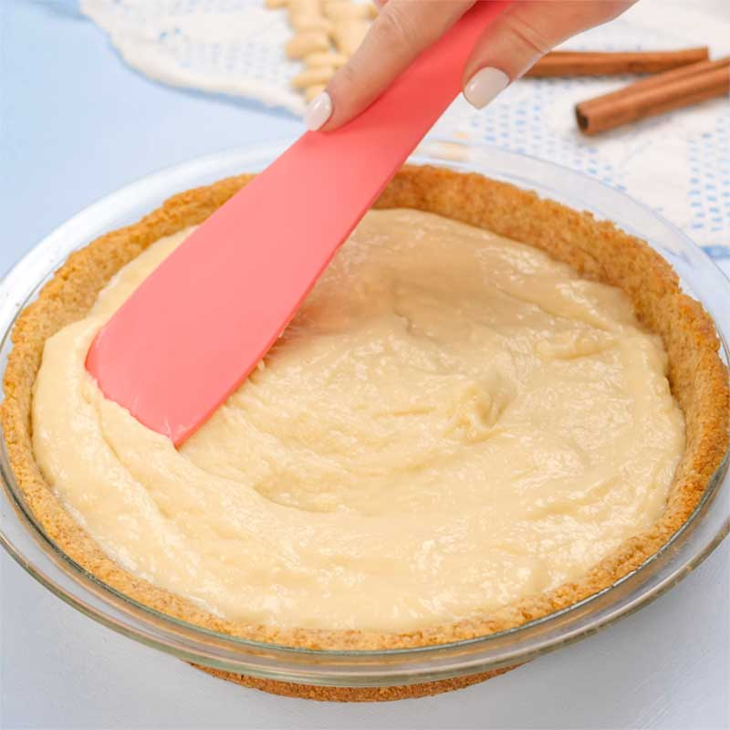 Keto Sugar Cream Pie crust being filled.