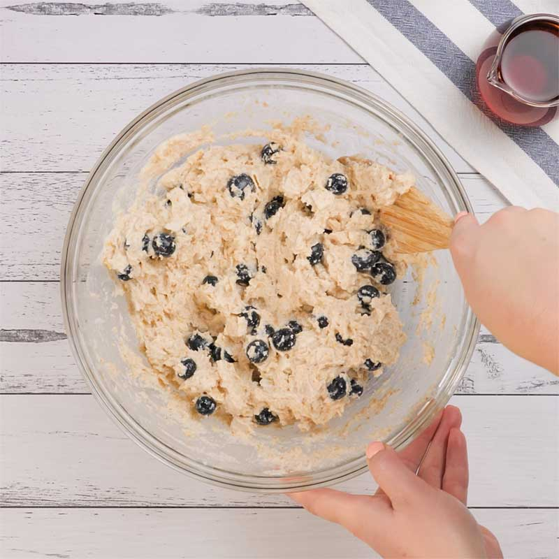 Keto Blueberry Baked Oatmeal Ingredients being mixed in a bowl