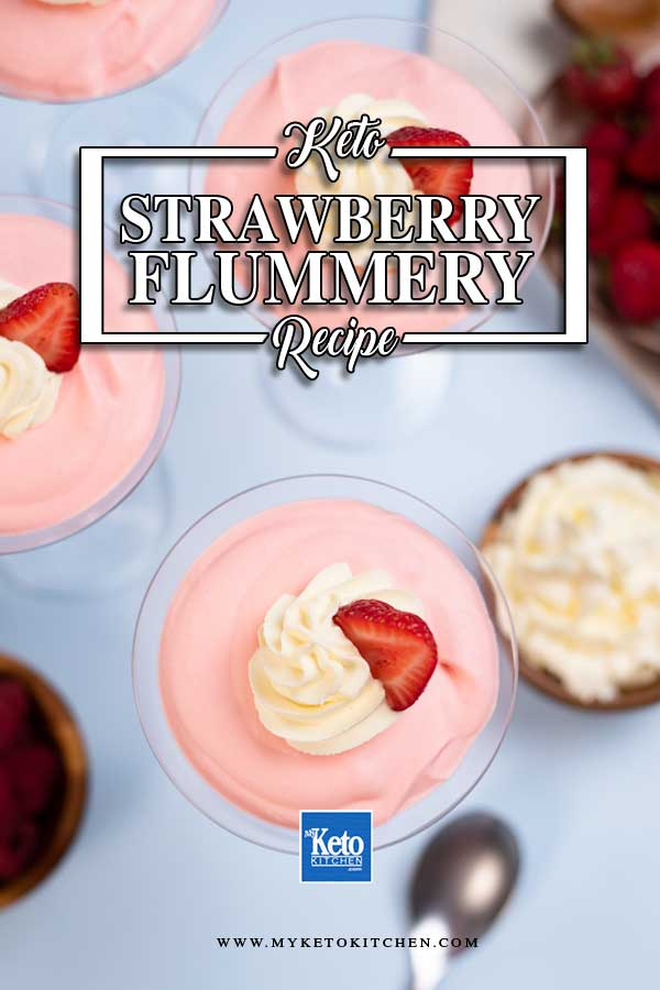 Keto Strawberry Flummery in martini glasses topped with whipped cream and strawberry slices.