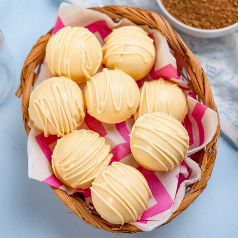 Keto White Chocolate Coffee Bombs in a basket.